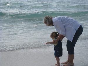 Grandmother and granddaughter at the seashore in Destin, Florida.