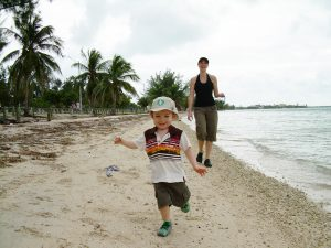 Mom and son enjoying the beach in Key Biscayne in Miami, FL. Photo by Steph Wiestling of BestKidFriendlyTravel.com