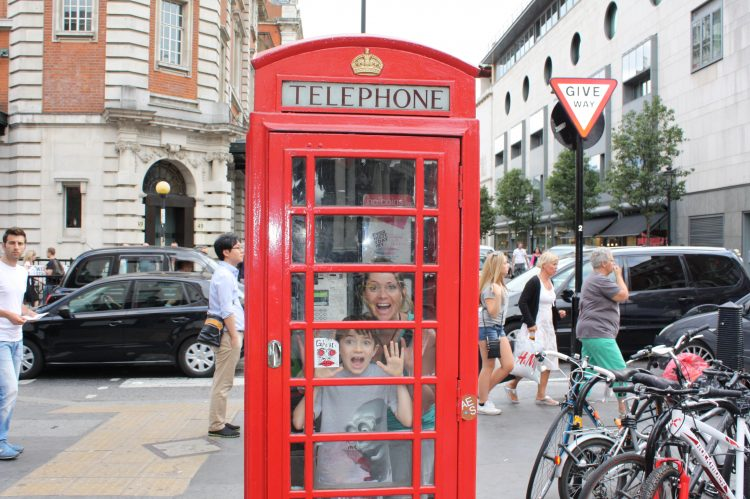 Iconic red telephone booths in London. Photo by Steph Wiestling of BestKidFriendlyTravel.com