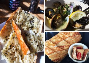 sourdough bread basket, steamed clams and sourdough garlic bread at Pier Market restaurant on Pier 39 at Fisherman's Wharf in San Francisco, California